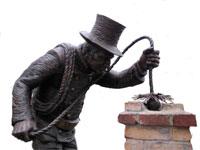 чистит трубы трубочист